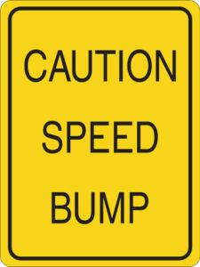 Caution speed bump sign